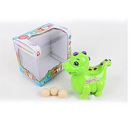 Заводная игрушка Динозавр ездит несет яйца