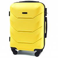 Дорожный чемодан пластиковый Wings 147 ручная кладь 4 колеса желтый