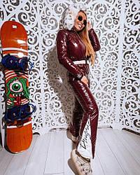 Женский зимний лыжный комбинезон декорированный мехом эко-рыси, вишневый цвет
