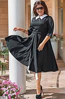 Платье черного цвета фасона бэби долл, белым воротником и белыми вставками вставками на концах пояса.