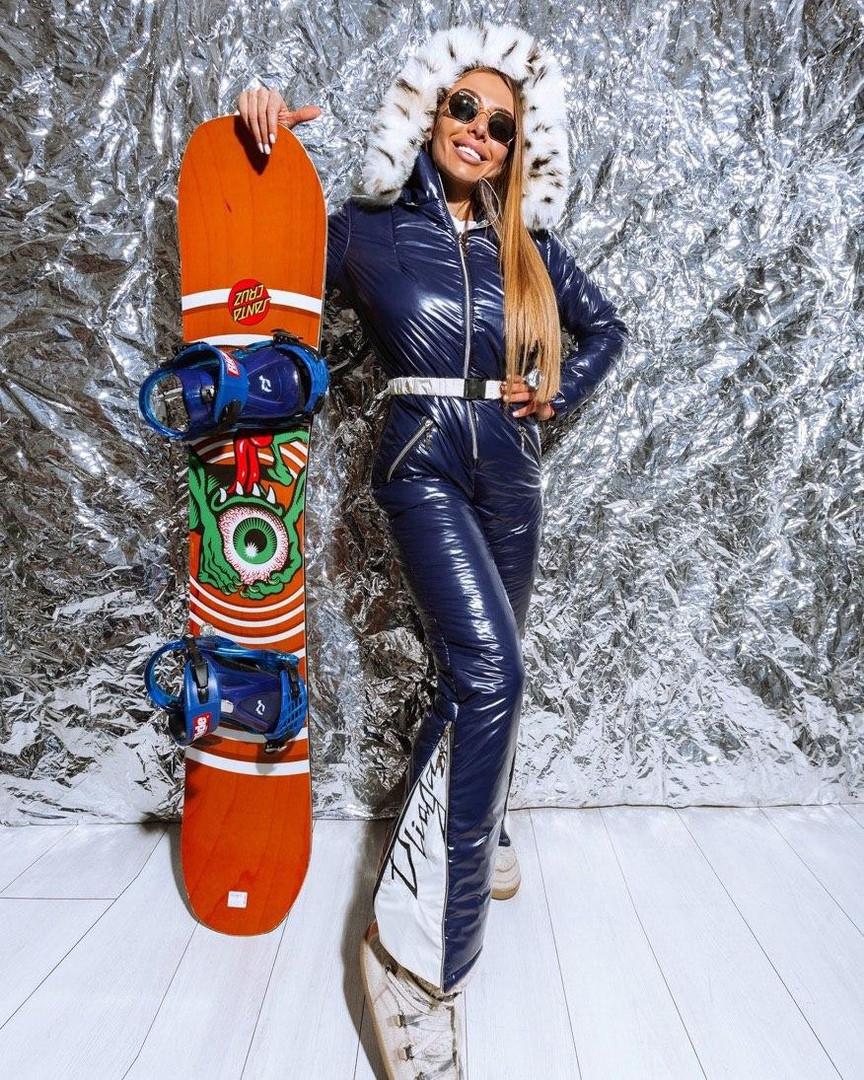 Женский зимний лыжный комбинезон декорированный мехом эко-рыси, синего цвета