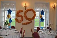 Юбилей 50 лет. Оформление ресторана цифрами на каркасе и фольгированными шарами.