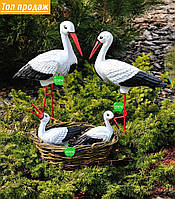 Садовая фигура Семья садовых аистов в гнезде №22