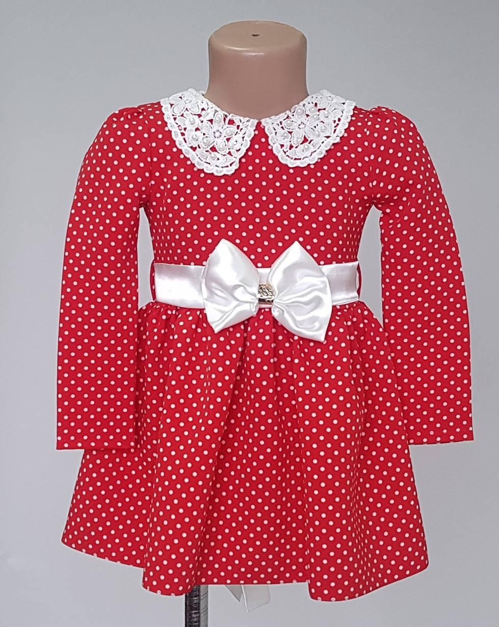 Красное детское платье в горошек с белым бантом