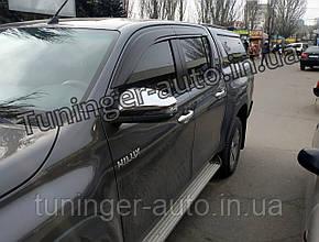 Ветровики, дефлекторы окон Toyota Hilux 2015- (HIC)