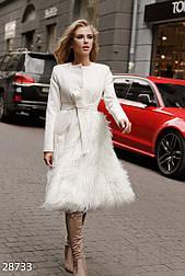Женское пальто с мехом ламы молочное