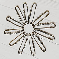 Булавка металлическая с колечками бронза