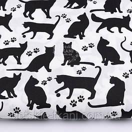 """Ткань хлопковая """"Коты и следы лапок"""" чёрные на белом фоне №2577"""