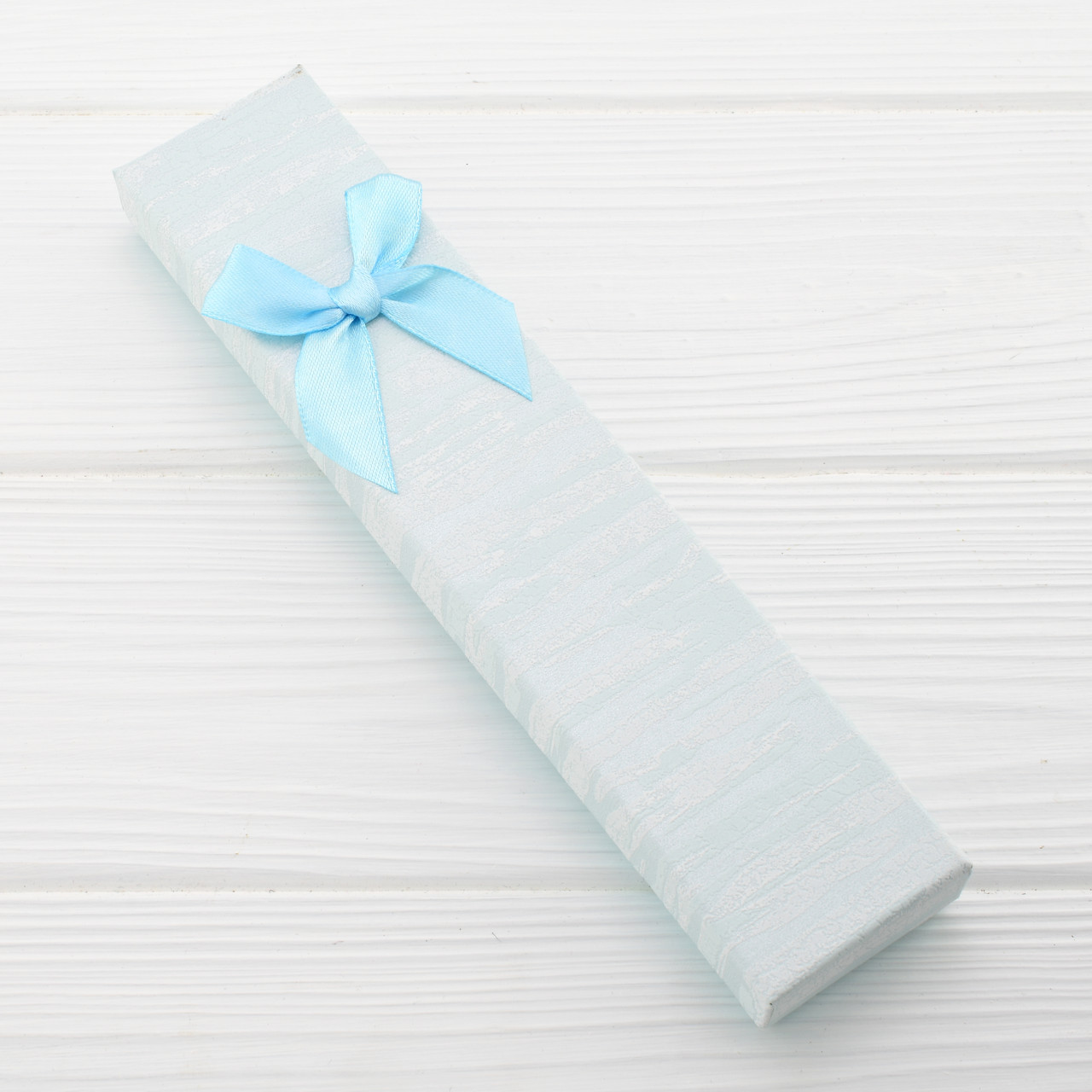 Футляр светло голубой 741230 для цепочек браслетов размер 21х4 см