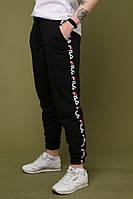 Штаны чёрные с чёрным лампасом Fila, фото 1