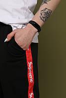 Штаны чёрные с красным лампасом Supreme, фото 1