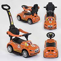 Каталка-толокар Joy оранжевый, на русском, родительская ручка, съемный защитный бампер, багажник - 220046