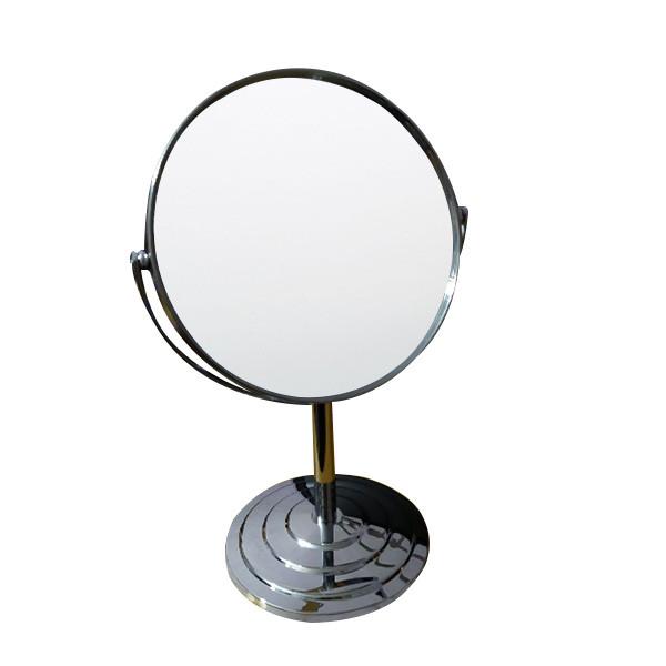 Двостороннє кругле збільшувальне дзеркало.