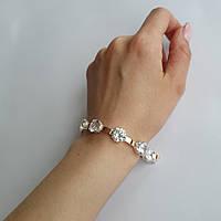 Серебряный браслет с золотыми напайками и крупным белым камнем 310у
