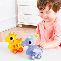 Музыкальная игрушка Hola Toys Стегозавр (6110D)