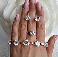 Серебряный набор с золотыми вставками кольцо и серьги + браслет с крупным белым камнем 310у