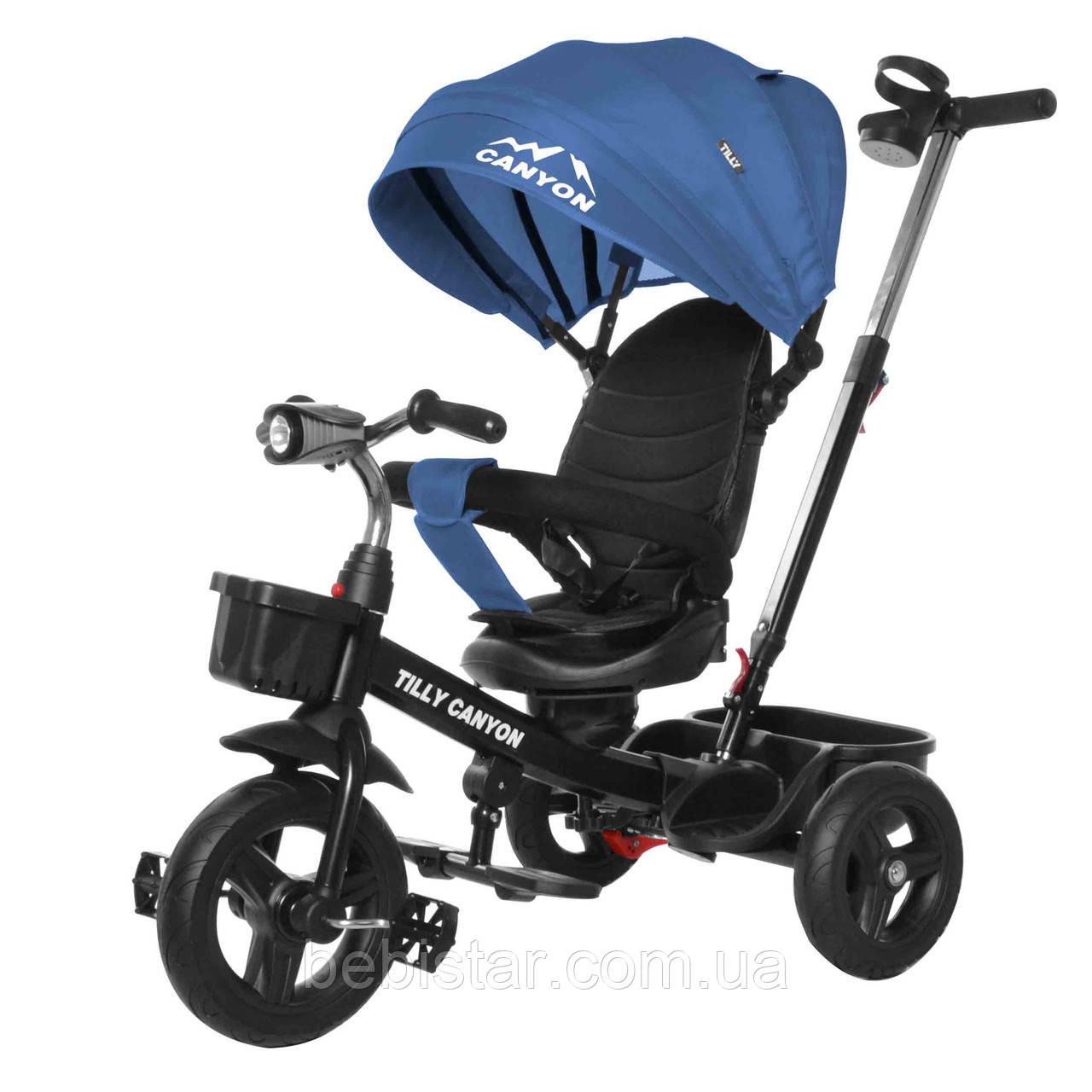 Трехколесный велосипед синий TILLY CANYON T-384 с поворотным сидением музыка и свет