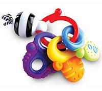 Nuby Игрушка-прорезыватель для зубов Nuby  разноцвет 19см (латекс)