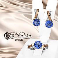 Комплект ювелирный из серебра и золота 375 пробы,инкрустирован голубыми фианитами размером 5*5 мм.