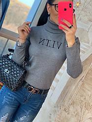 Стильный женский свитер из трикотажа с вышивкой
