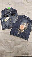 Жилетка джинсовая для девочки 3-7 лет синего цвета с принтом оптом