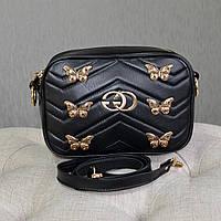 Кожаная женская сумка черного цвета, декорирована фурнитурой. Производство Украина
