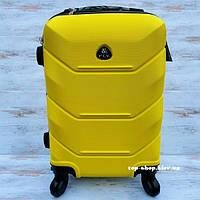 Пластиковый чемодан на колесах для ручной клади Fly 31 л (маленький) желтый
