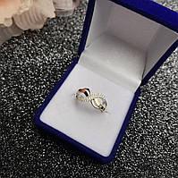 Серебряное кольцо *Бесконечность* 925 пробы с золотом 375 пробы с белым фианитами.