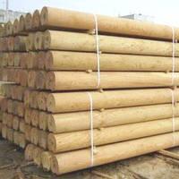 Оцилиндрованные бревна для строительства домов и бань.