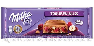 Шоколад Milka Лісові горіхи, родзинки і молочний шоколад 270 р. Швейцарія