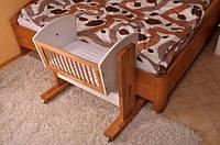 Приставная кроватка к кровати для новорожденных