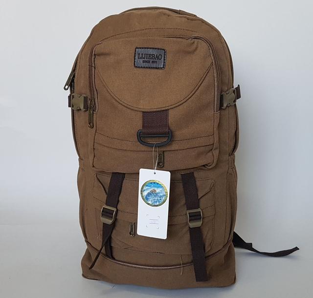 фотография большой брезентовый рюкзак песочного цвета