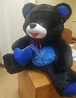 Мягкая игрушка DreamToys Медведь Улыбка, сидячий с сердцем, черно-синий, 55см, 339018