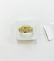 Ошатне кільце у золотому кольорі усипане сяючим камінням