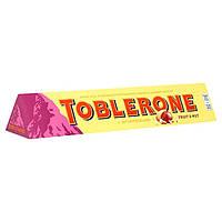 Шоколад молочный Toblerone изюм и орехи 100г