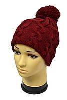 Бордовая вязанная шапка с объемными косами