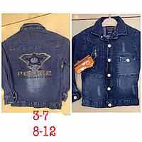 Куртка джинсовая для мальчика на 8-12 лет синего цвета с нашивками оптом