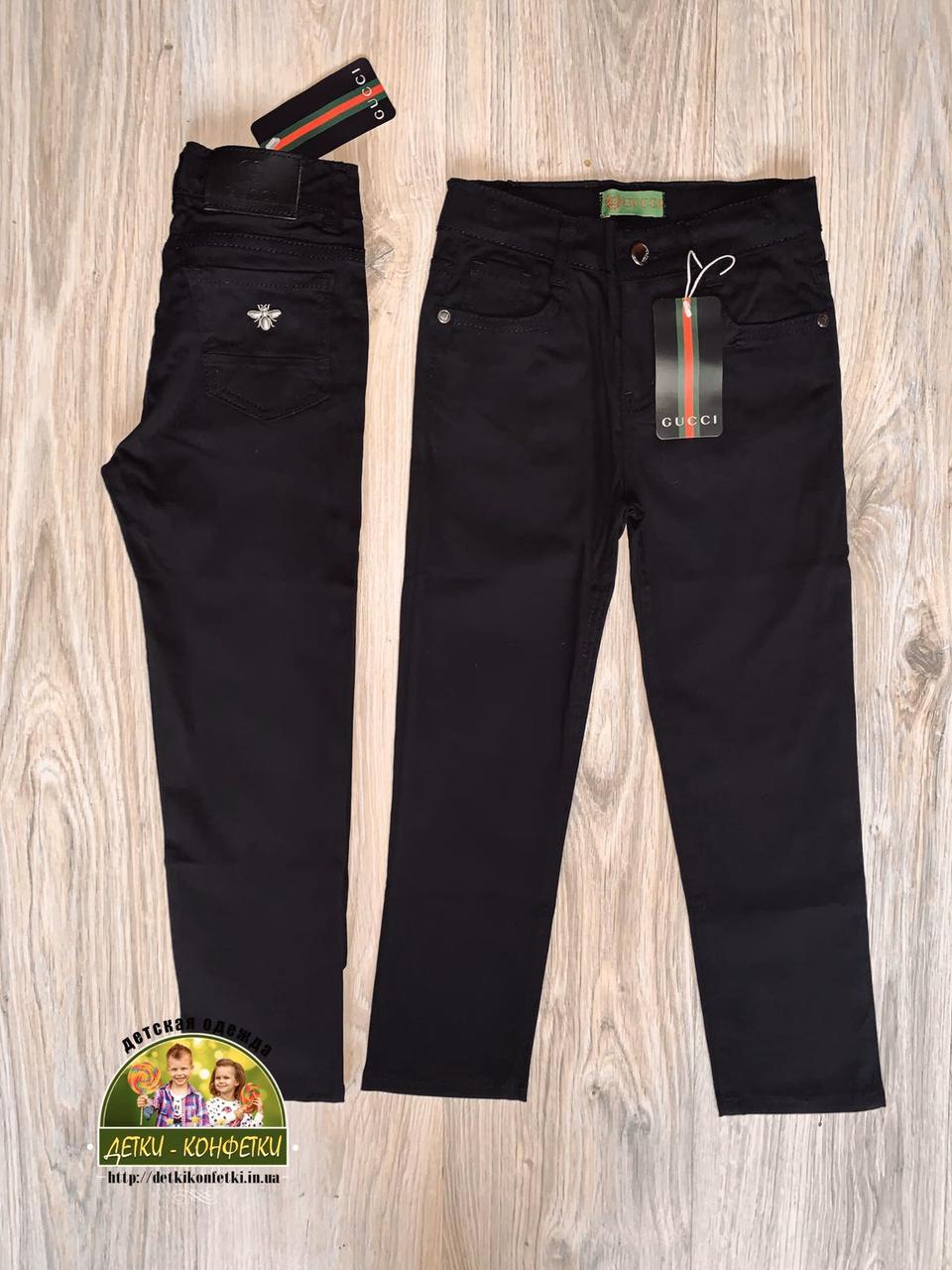 Черные джинсы Gucci для мальчика