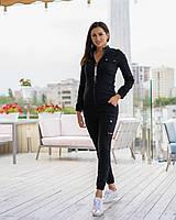 Спортивный женский костюм с манжетами черный