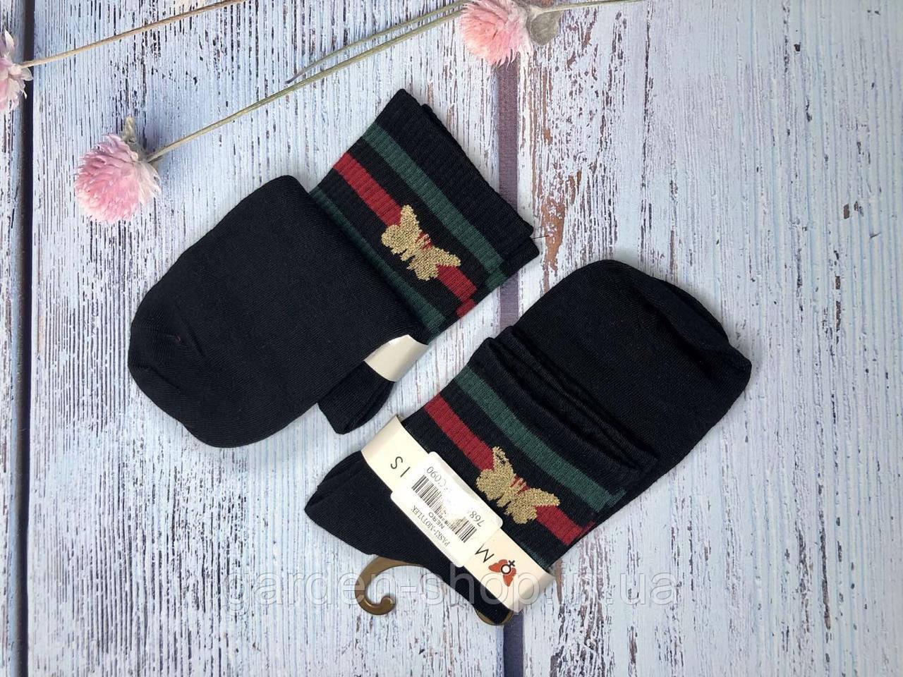 Жіночі шкарпетки Magnetis чорні з полосками та метеликом