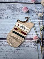 Жіночі шкарпетки Magnetis бежеві з полосками та метеликом, фото 1
