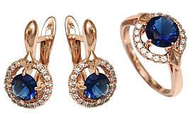 """Набор фирмы Хuping""""серьги и кольцо""""Цвет:позолота с красным оттенком.Камни:белый и синий циркон.Есть только 17р"""