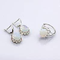 Серебряное кольцо и серьги с лунным камнем