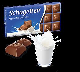 Шоколад Шогеттен Alpine Milk молочний з шматочками лісового горіха 100 грам
