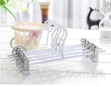 Вешалка с прищепками в силиконе белого цвета хромированная, 35см