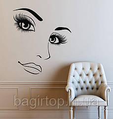 Інтер'єрна вінілова наклейка на стіну Обличчя дівчини