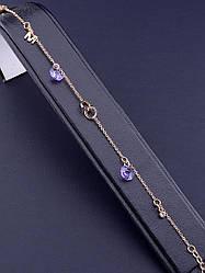 Браслет на руку гибкий с фиолетовыми камнями Swarovski и буквами, длина  19 см. (позолота 18к)