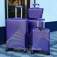 Большой L чемодан из поликарбоната премиум серии на 4-х двойных колесах с ТСА замком Фиолетов