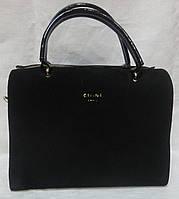 Женская сумка из лака и замша.