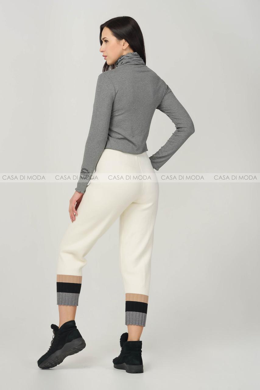 Теплые женские спортивные штаны.
